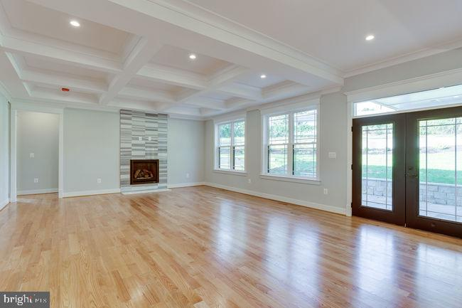Family room with french doors opening to patio. - 7022 HECTOR RD, MCLEAN