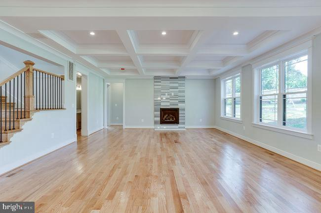 Family room with gas fireplace with  marble tiles. - 7022 HECTOR RD, MCLEAN