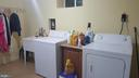 Laundry section with utility sink - lower level - 6216 STONEHAM RD, BETHESDA