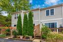 Evergreens provide deck privacy - 820 MEWS LN, FREDERICK