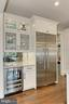 Bar area with wine fridge & glass front cabinets - 900 GLYNDON ST SE, VIENNA