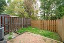 Fenced yard features a large patio - 8461 SUGAR CREEK LN, SPRINGFIELD