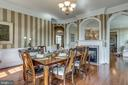 Formal dining room with gas fireplace - 19607 ABERLOUR LN, LEESBURG