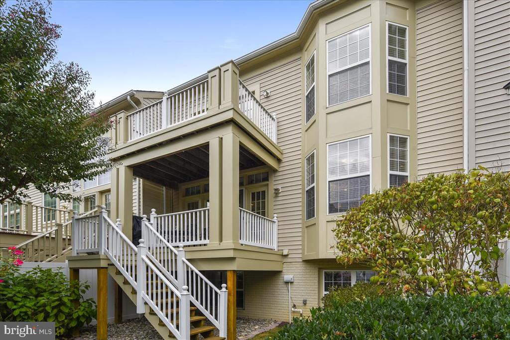 Two-level decks off family Room and Master Bedroom - 43433 WILD DUNES SQ, LEESBURG