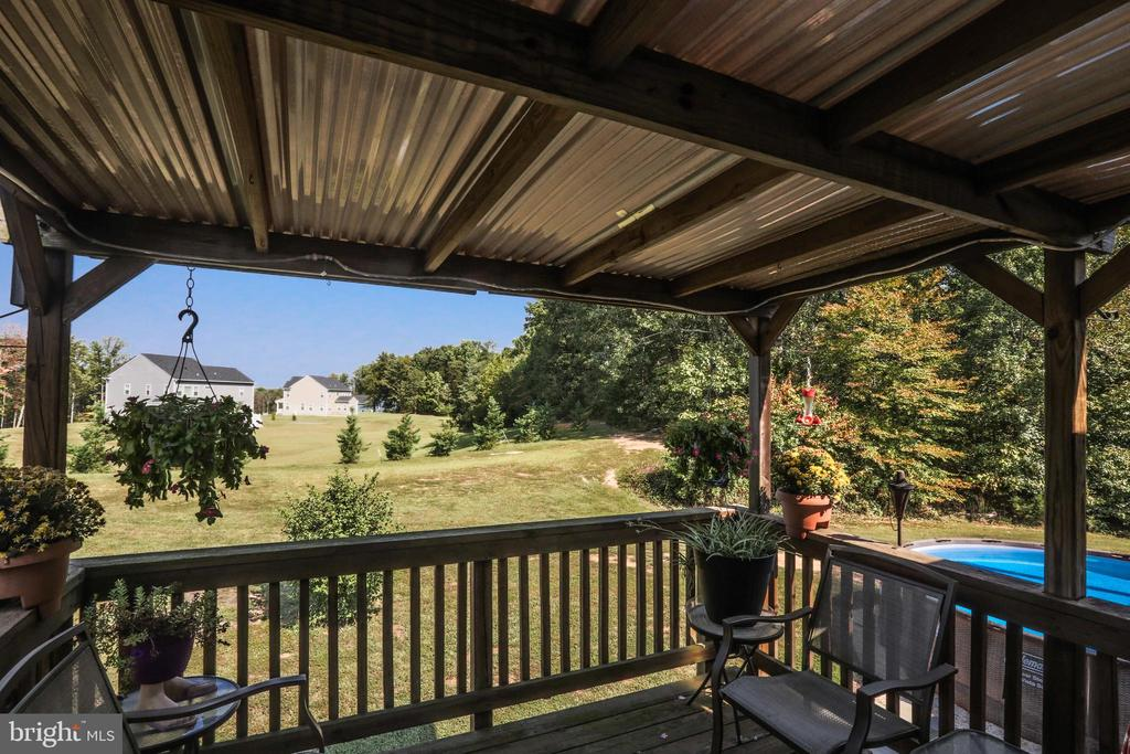Covered deck of the kitchen overlooking the pool - 1799 COURTHOUSE RD, STAFFORD