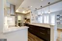 Kitchen - Carrara marble counters w/waterfall edge - 1901 WYOMING AVE NW #11, WASHINGTON