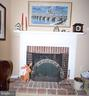 Brick fireplace in Living Room - 11690 STOCKBRIDGE LN, RESTON