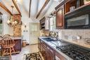 Original exposed beam in spacious kitchen. - 140 MARKET ST, ANNAPOLIS