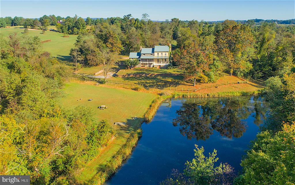 Beautiful stocked pond setting - 19923 WOODTRAIL RD, ROUND HILL