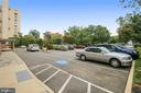 Large visitor parking lot in front of building - 1401 N OAK ST #307, ARLINGTON