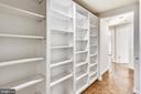Built-in bookcases in hallway - 1401 N OAK ST #307, ARLINGTON