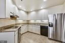 Kitchen with new SS side-by-side refrigerator - 1401 N OAK ST #307, ARLINGTON