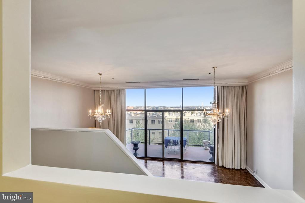 View from kitchen to living room and balcony - 1401 N OAK ST #307, ARLINGTON