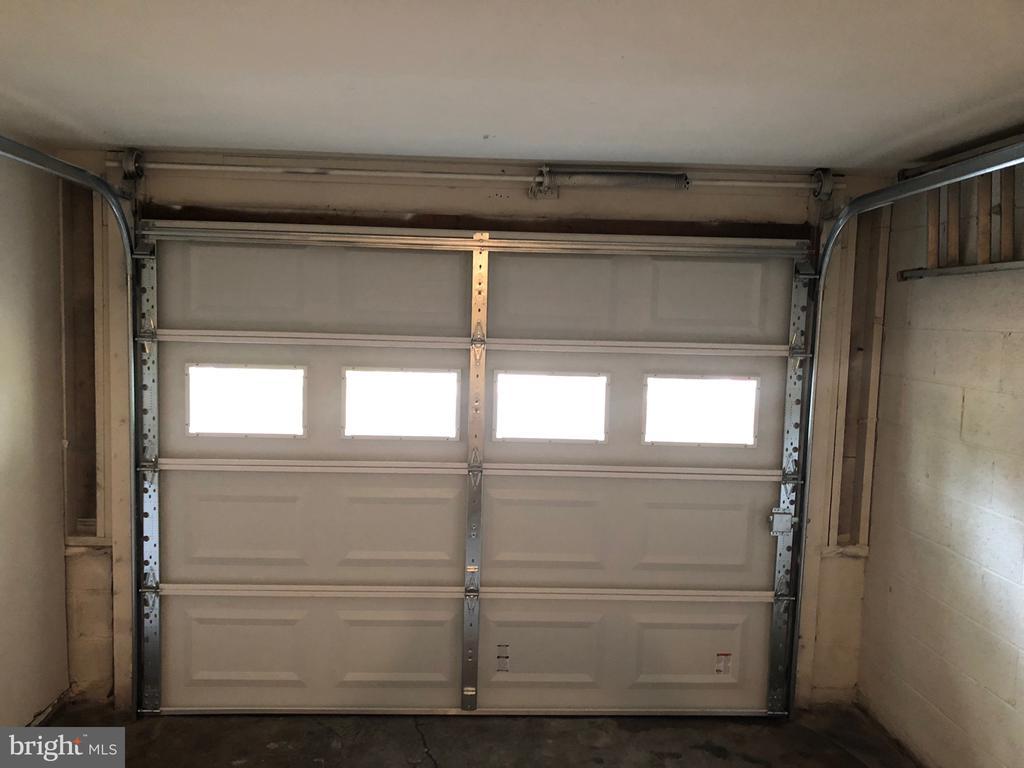 New garage door INSTALLED - 13227 NASSAU DR, WOODBRIDGE