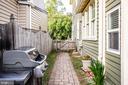 Side yard with brick paver side walk - 1109 DOUGLAS ST, FREDERICKSBURG