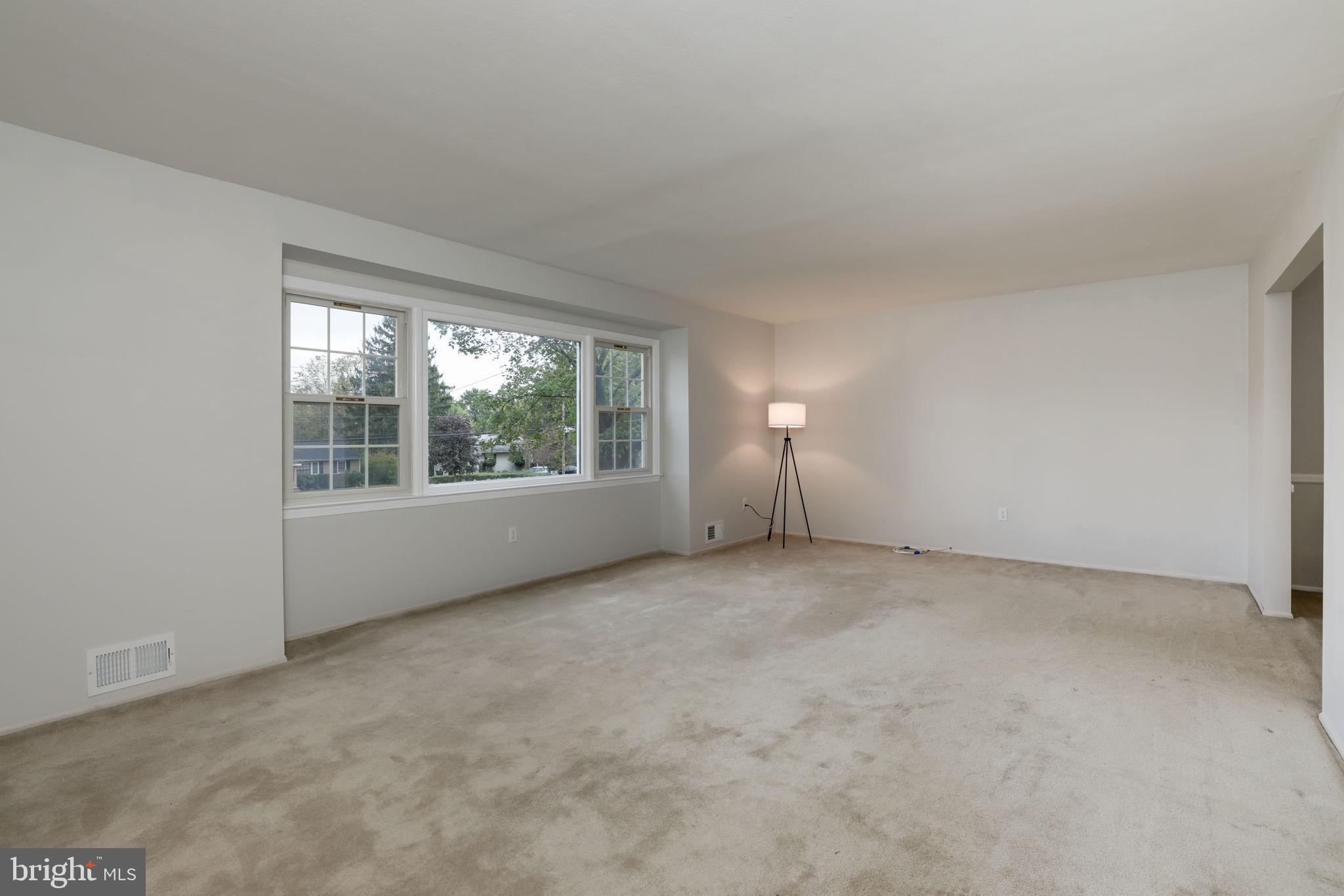 living room w/ hard wood floors under the carpet