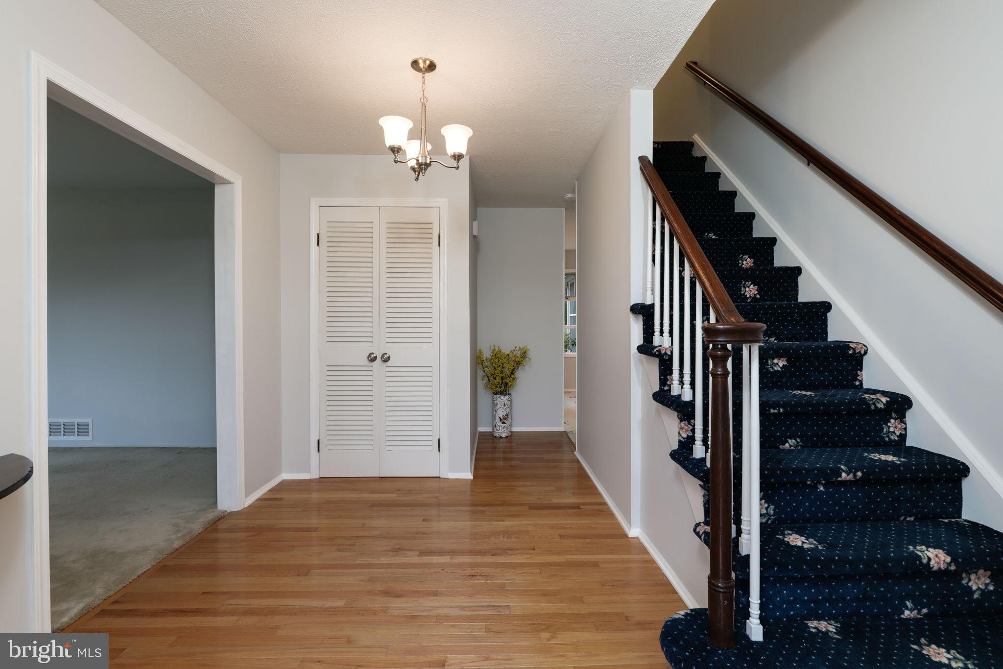 large foyer with coat closet