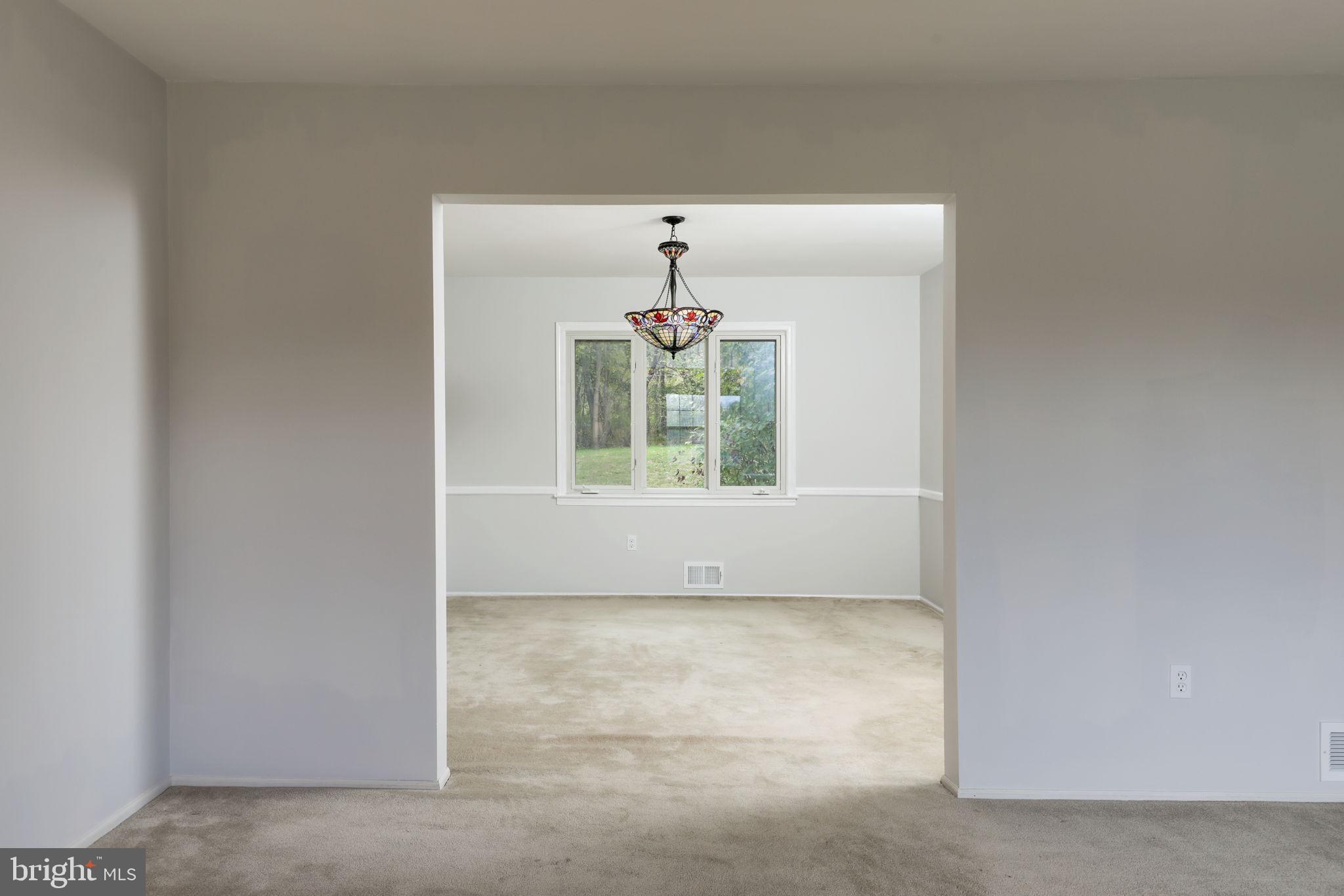 dining room, w/ hard wood floors under the carpet