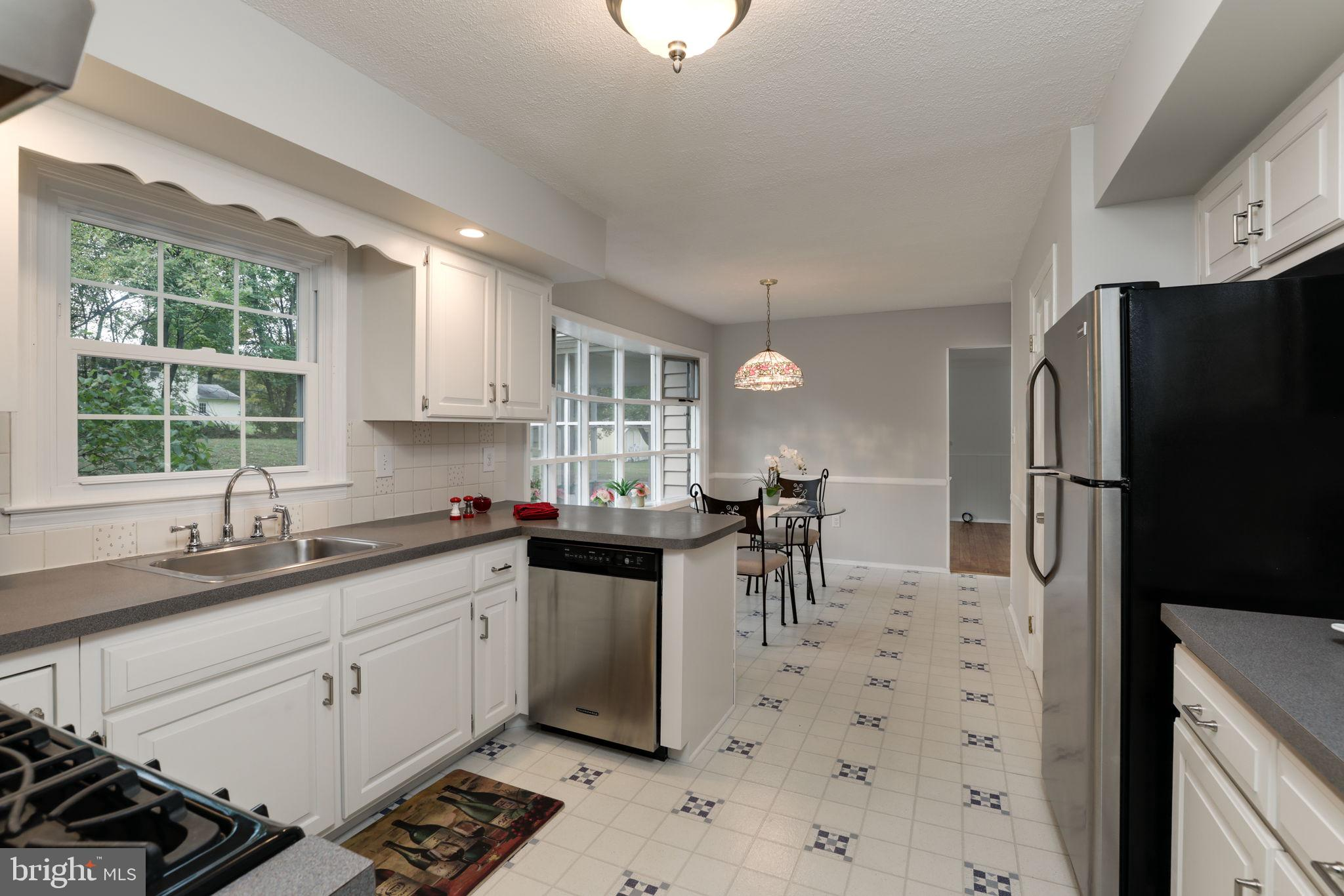 remodeled eat in kitchen with SS appliances