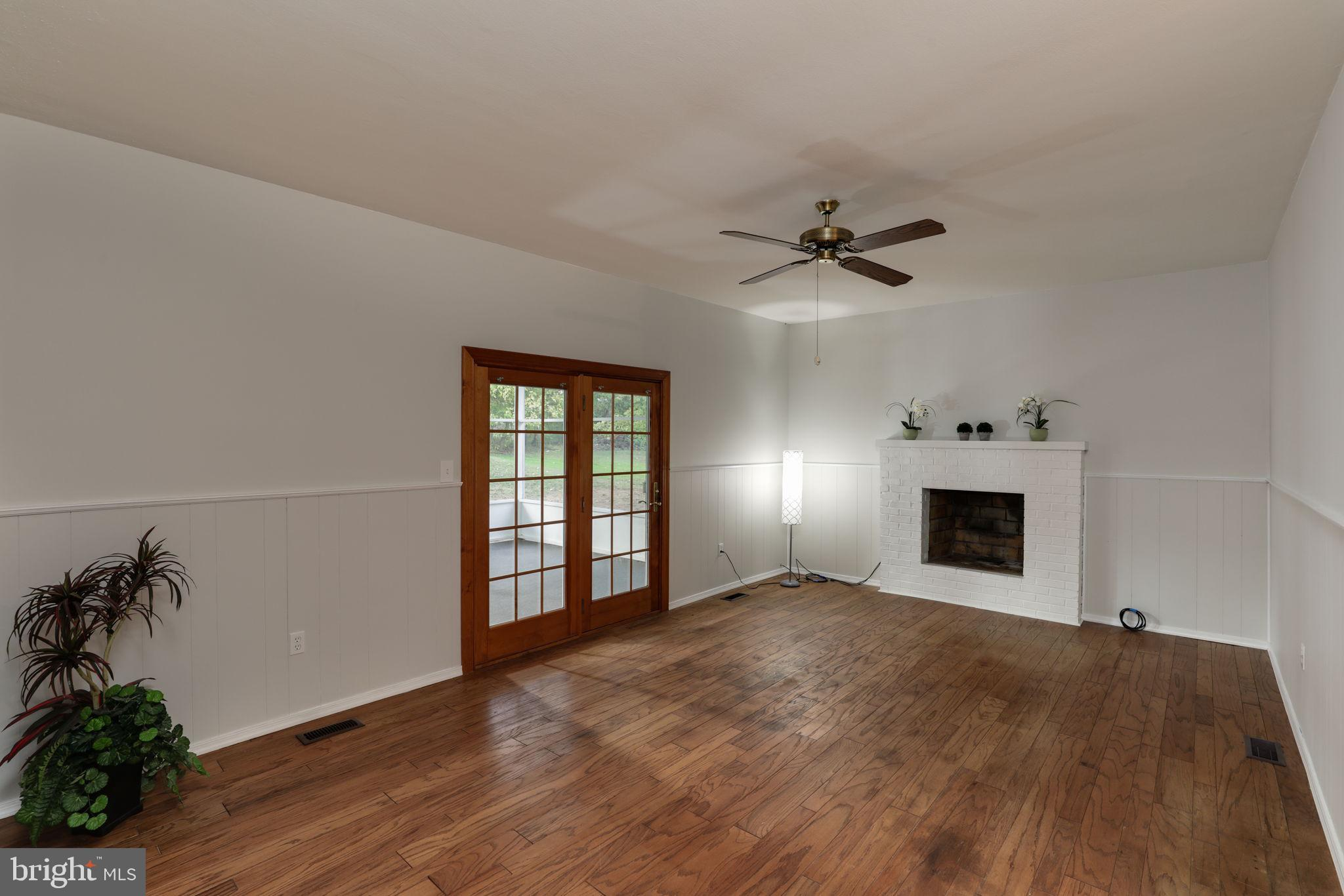 family room with access to screened in back porch