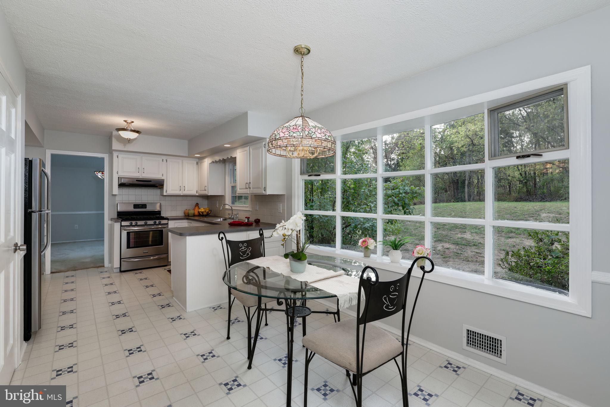 eat in kitchen w/picture window overlooking  back