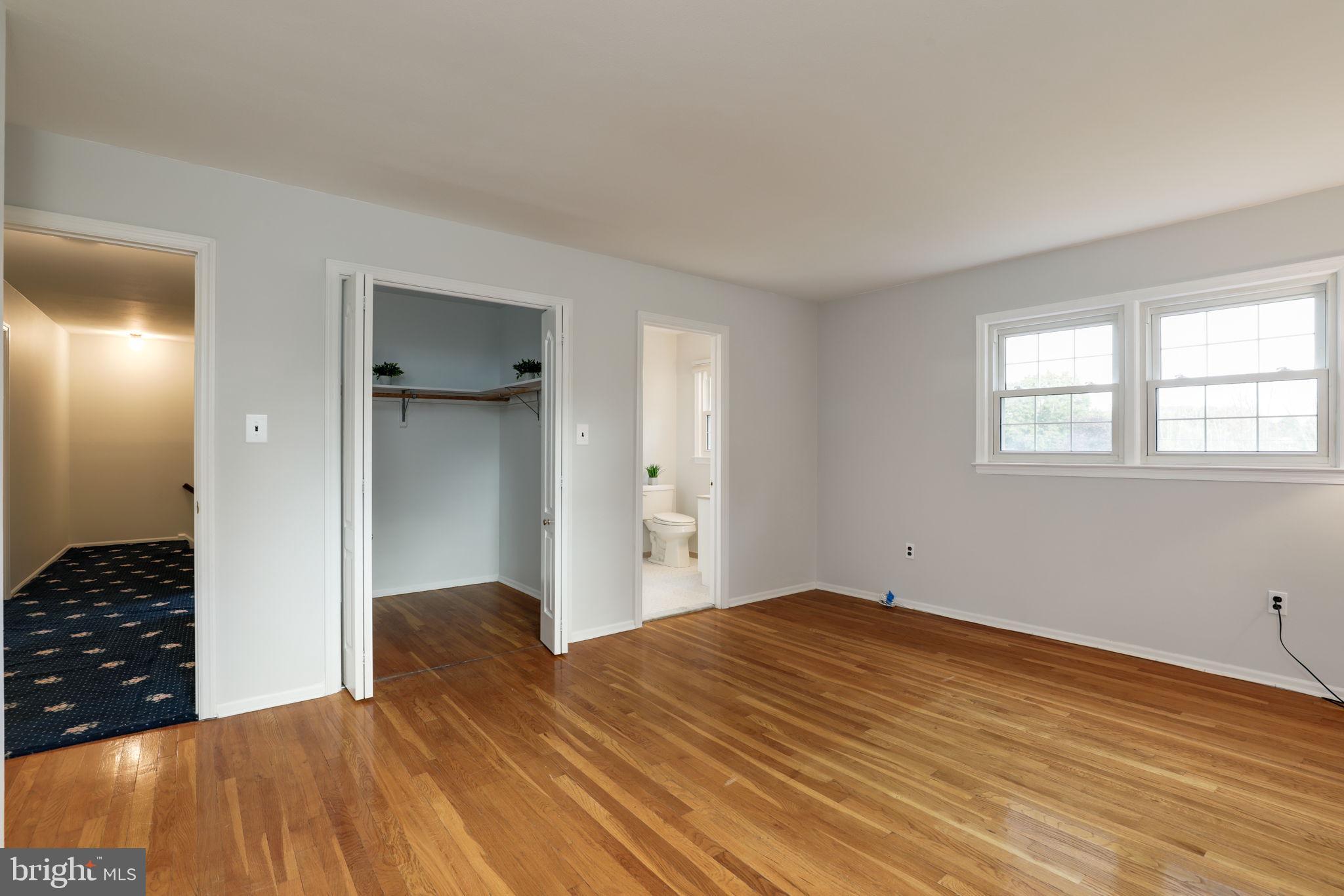 master bedroom with walk in closet & en suite bath