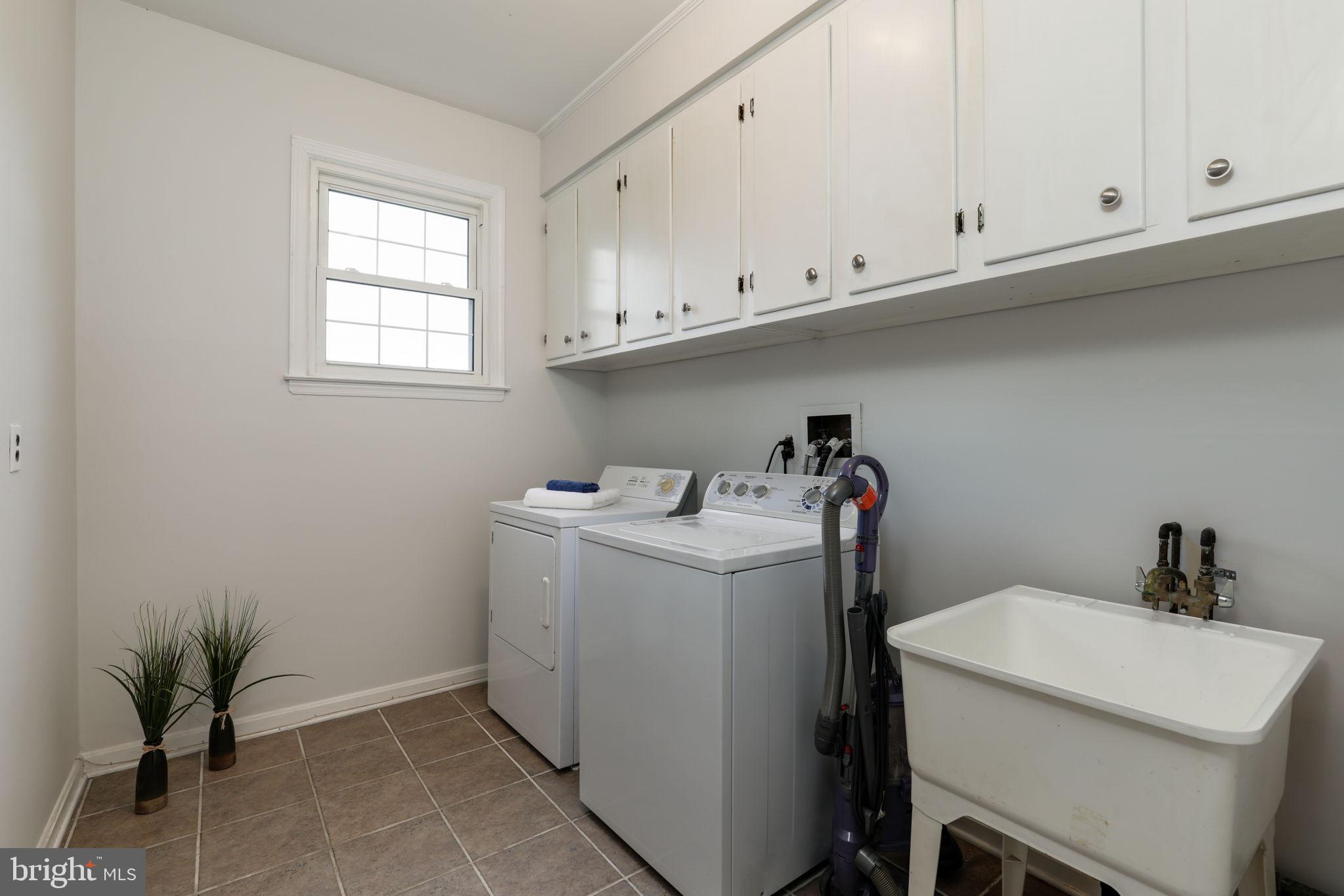 first floor laundry room with natural light