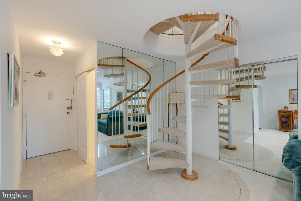 Spiral staircase from upper hall to studio - 1200 NASH ST N #550-561, ARLINGTON