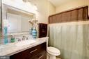 The hall full bath. - 7706 HAYNES POINT WAY #D, ALEXANDRIA