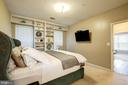 The master bedroom has built in shelving. - 7706 HAYNES POINT WAY #D, ALEXANDRIA