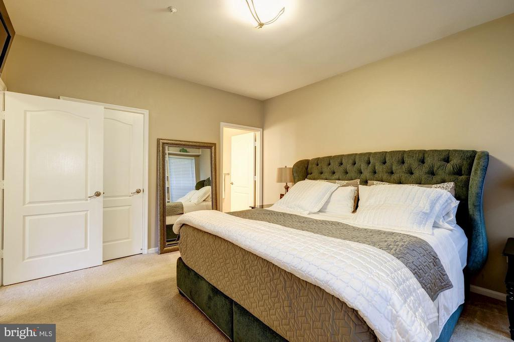 The master bedroom is huge. - 7706 HAYNES POINT WAY #D, ALEXANDRIA