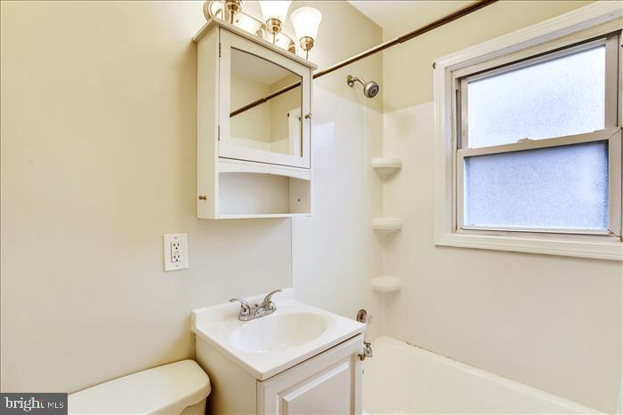 Updated floors, cabinet, and lights in full bath. - 508 CARROLL AVE, MOUNT AIRY