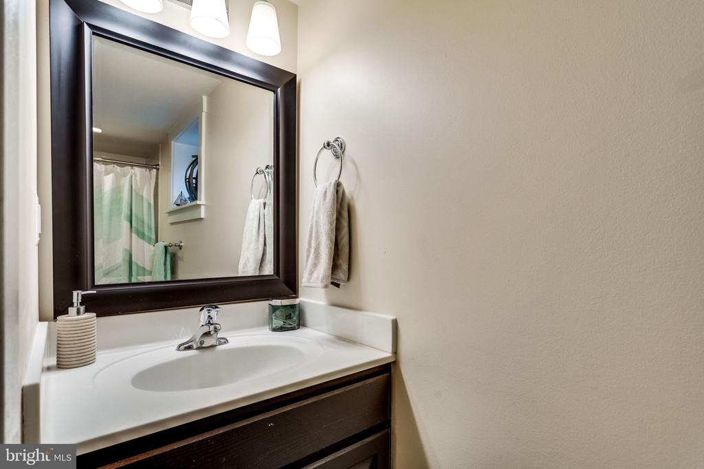 There are fresh towels under the sink - 5720 OAK HILL PL, ALEXANDRIA