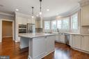 A portfolio of kitchen design options. - 1522 CROWELL RD, VIENNA