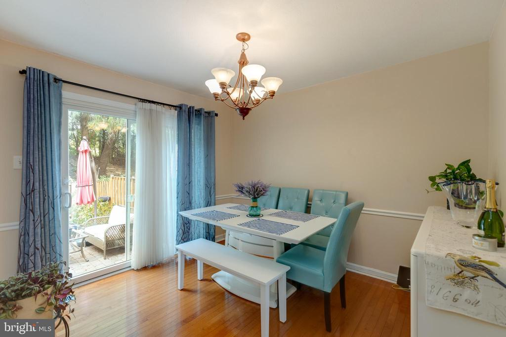 Dining room with sliding glass doors to the yard - 4449 HOLLY AVE, FAIRFAX