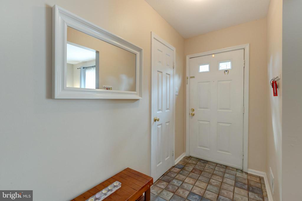 Front door with powder room to the left - 4449 HOLLY AVE, FAIRFAX