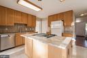 Kitchen with granite and tile backsplash - 40 LAKESIDE DR, STAFFORD
