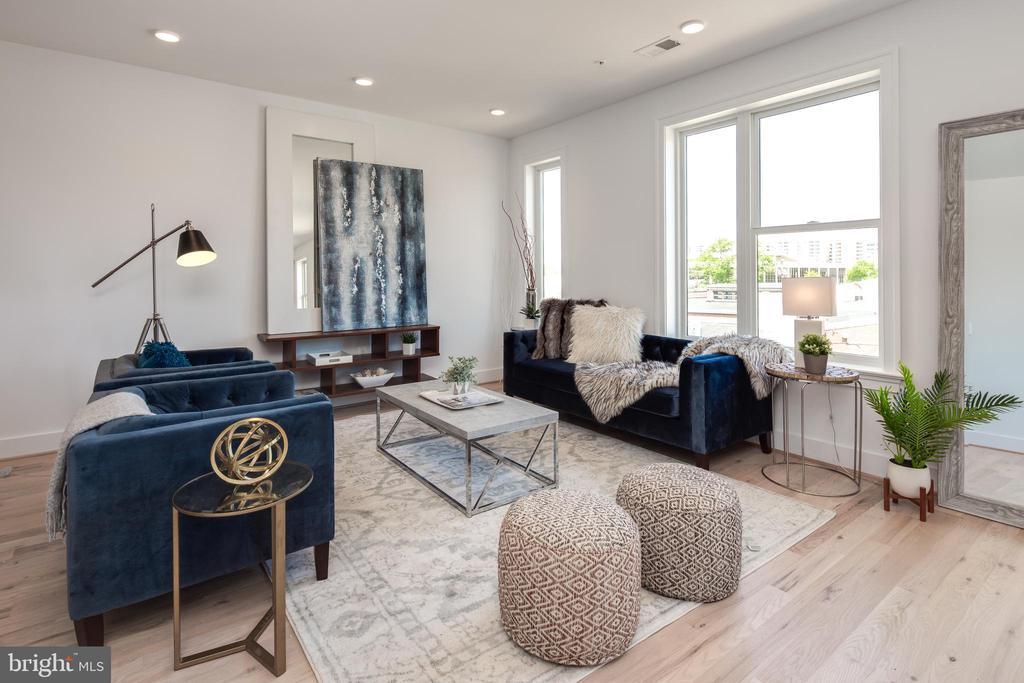 Photo of a Similar Unit: Living Room - 4335 HARRISON ST NW #8, WASHINGTON