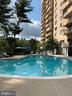 Stunning Outdoor Pool - 1st View - 1101 S ARLINGTON RIDGE RD #903, ARLINGTON