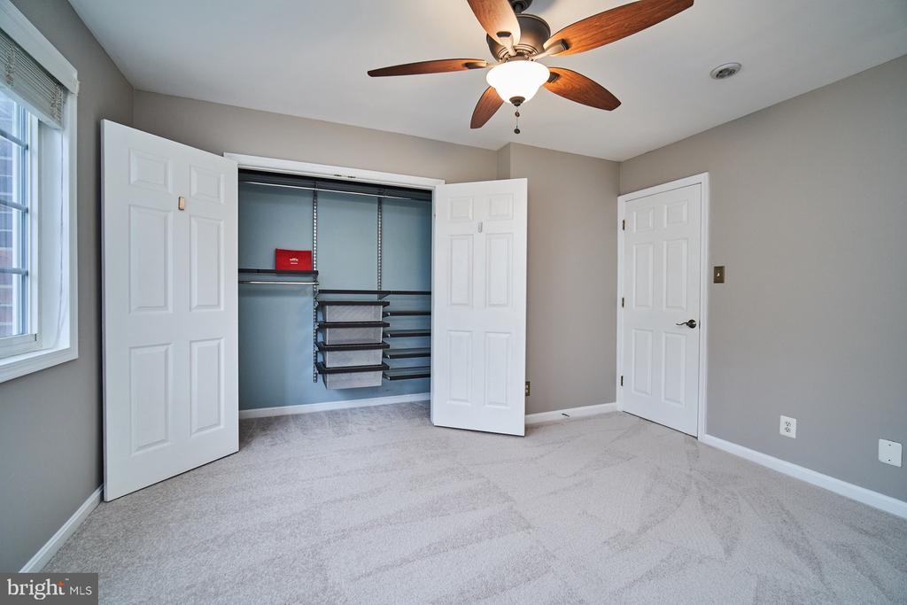 Master bedroom with custom ELFA shelving - 1289 N VAN DORN ST, ALEXANDRIA