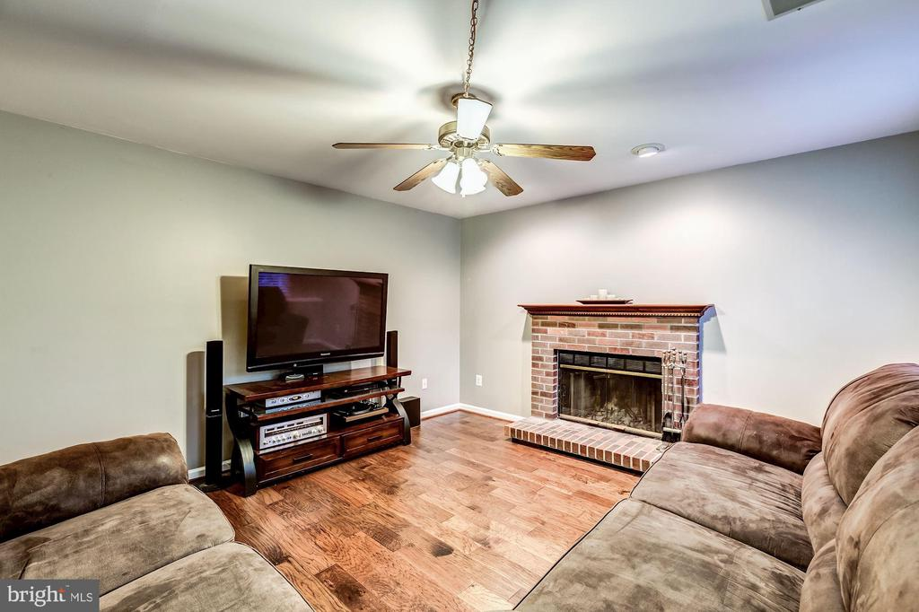 Family Room - Cozy Brick Fireplace is Focal Point! - 20617 PREAKNESS CT, ASHBURN