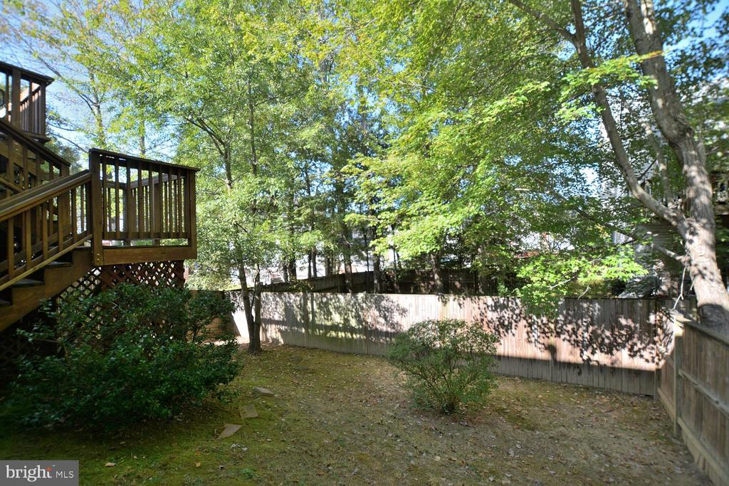 Tree view in fenced backyard with Deck - 9315 PAUL DR, MANASSAS PARK