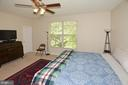 Master Bedroom with walk in closet and ceiling fan - 9315 PAUL DR, MANASSAS PARK