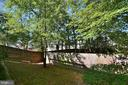 Nice size back yard with trees and lawn, - 9315 PAUL DR, MANASSAS PARK