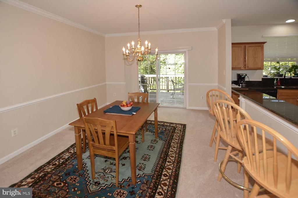 Separate formal dining room with slider to deck - 9315 PAUL DR, MANASSAS PARK