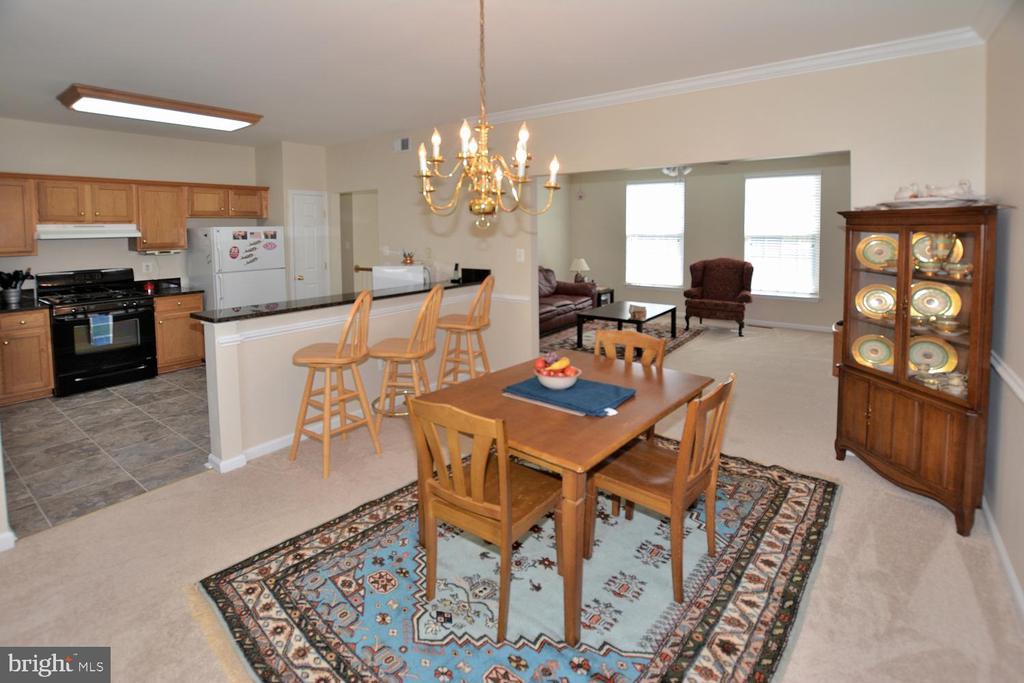 Dining room, living room & kitchen w/ bar counter - 9315 PAUL DR, MANASSAS PARK