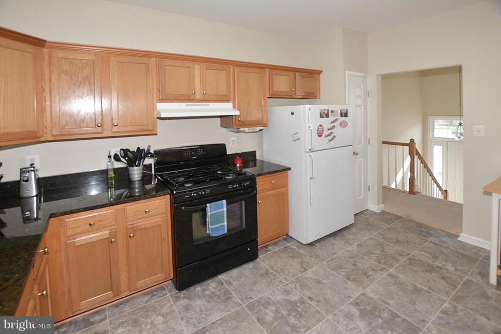 Newer flooring in the eat in kitchen - 9315 PAUL DR, MANASSAS PARK