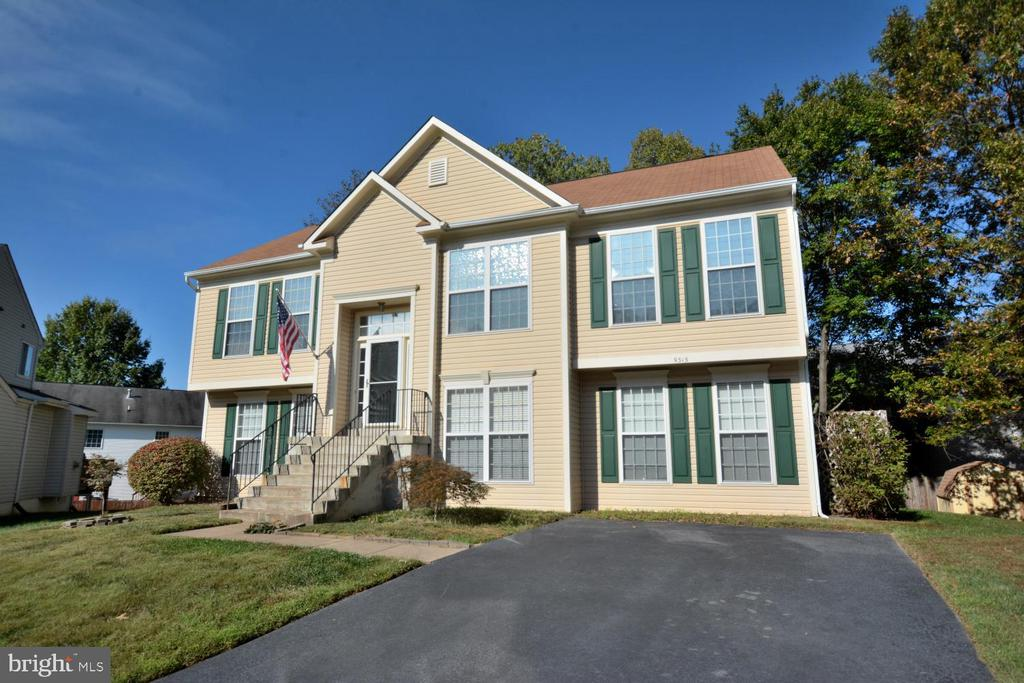 The beautiful home sits well on its  culdesac lot - 9315 PAUL DR, MANASSAS PARK
