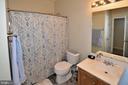 Main level guest full bath with door to MBR. - 9315 PAUL DR, MANASSAS PARK