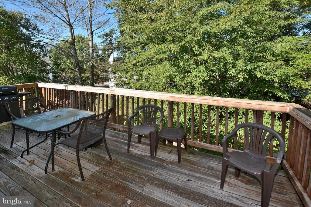 Back yard deck with tree view - 9315 PAUL DR, MANASSAS PARK